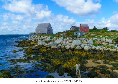 View of rocky shore and waterfront houses in the fishing village Indian Harbour, Nova Scotia, Canada