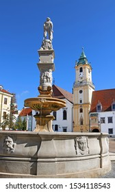 View of Roland Fountain and Old town hall at Main Square (Hlavne namestie) in Bratislava Old Town, Slovakia. The fountain was constructed in 1572 for supplying citizens of the city with water