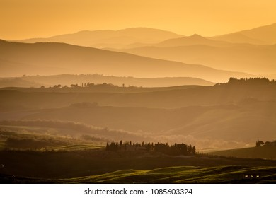 View of rolling countryside at sunset, Pienza,  Tuscany, Italy