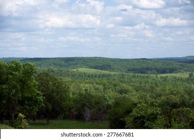 A view of rolling hills in rural Missouri.