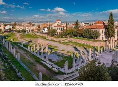 View of the Roman Agora in Athens, built during the Roman period, with the Fethiye Mosque on the right and neoclassical buildings in the background. Athens, Greece, December 2018.