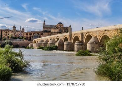 View of Roman bridge of Cordoba (1st century BC) across Guadalquivir River. Present structure of bridge dates from Moorish reconstruction in VIII century. Historic centre of Cordoba, Andalusia, Spain.