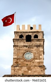 View of the Roman Clock Tower with Turkish flag in Antalya, Turkey