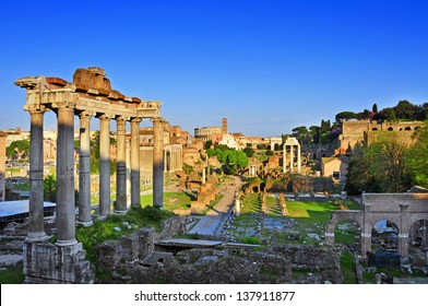 a view of the Roman Forum in Rome, Italy, with the Coliseum in the background
