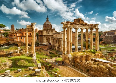 View of Roman Forum with the Temple of Saturn, Rome, Italy. Roman Forum is one of the main travel destinations in Europe. Beautiful panorama of Roman Forum in summer. Ancient ruins in central Roma.