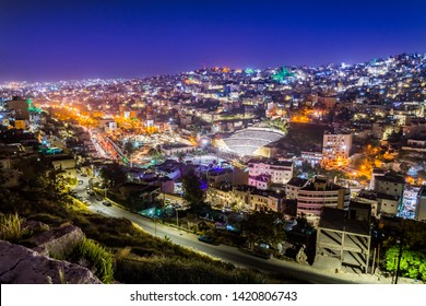 View of the Roman Theater and the city of Amman at night, Jordan
