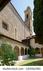 view of Romanesque cloister and church of monastery in village on shore of Garda lake, shot in bright fall light at Gargnano, Brescia, Italy