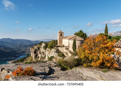 view of the romanesque style medieval christian church of siurana village in priorat region in autumn, spain. close