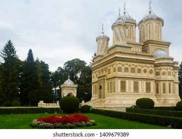 View of Romanian Orthodox Cathedral of Curtea de Arges in sunny autumn day