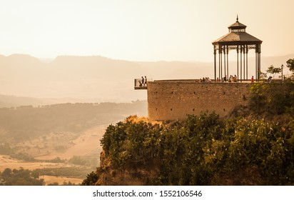 A view of Ronda in Andalusia, Spain. The bandstand and viewpoint are perched on the very edge of a high cliff on which the town is built.