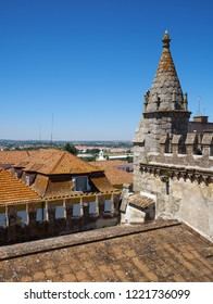 The view from the roof of the Evora Cathedral (Se) decorated with crenellations and the turret on the nearby residential houses.  Evora. Portugal