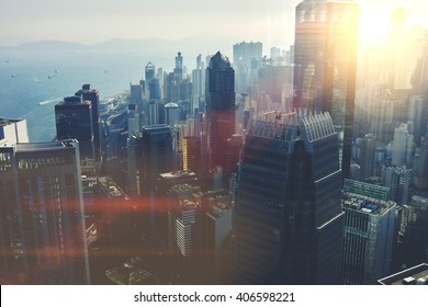 View from the roof of a modern city with tall office and commercial buildings at beautiful sunset. Developed business district with high skyscrapers with contemporary architecture in New York