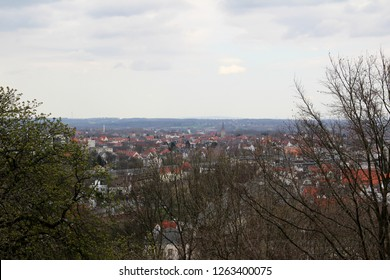 view from the roof top of the sparrenburg with cloudy sky in bielefeld germany photographed during a sightseeing tour at a sunny day