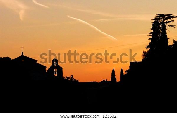 view of the roofs of the roman forum at sunset