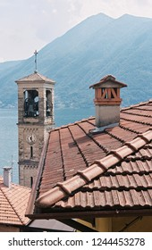 View of rooftop, church and mountains of Lake Como, Italy