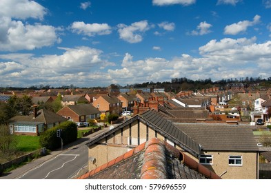 View from the rooftop, top view on the street,detail of roofing classic typical english architecture buildings and estates, british neighborhood, spring weather in UK, Midlands Warwickshire Rugby