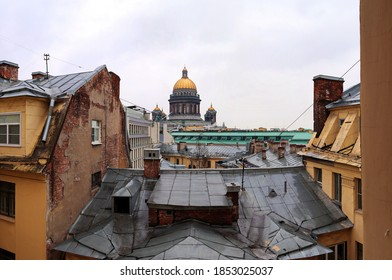 view of the rooftops of the old city with the cathedral in the background.