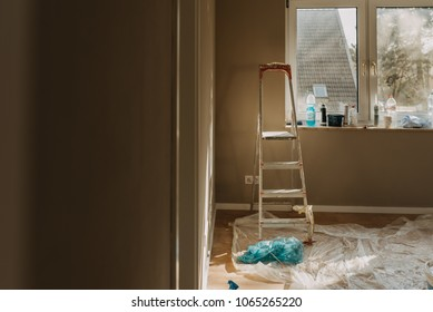 view of room aftre renovation with tools and stepladder