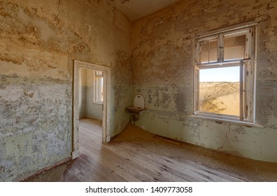 View from a room in a deserted building in hot Namibian desert.
