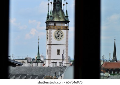 View from the room in Olomouc in Bohemia. Focus is on the tower clock.  /  View from the window