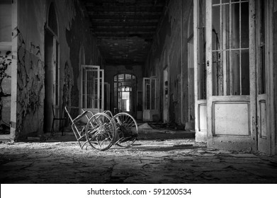 View of a room with wheelchair abandoned in the Psychiatric Hospital of Volterra in Tuscany. Italy Processing Black and White.