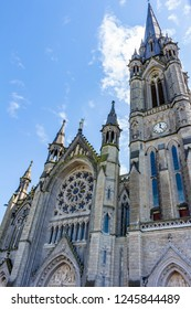 View of the roseton and the tower of St Colman's Cathedral, in the city of Cobh, Ireland