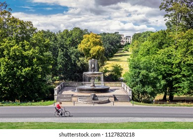 View of the Rossbrunnen fountain and the hill with the ruins Ruinenberg in Sanssouci park in Potsdam, Germany