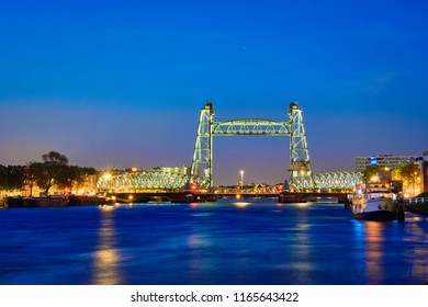 View of Rotterdam landmark De Hef - the first railroad bridge of its kind in Europe illuminated at night. Rotterdam, Netherlands