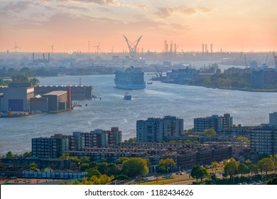 View of Rotterdam port and Nieuwe Maas river with cruise liner ship  on sunset