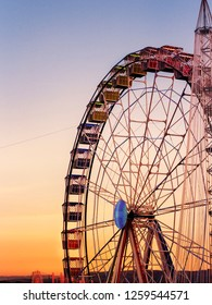 view of rounded colorful  ferris whell at sunset  in Madrid.Spain