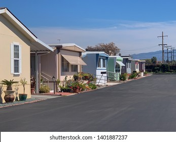 View of row of mobile homes in trailer park.