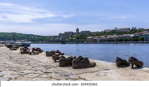 A view of the Royal Palace in Budapest with a reminder of the holocaust victims on the banks of the River Danube during summertime