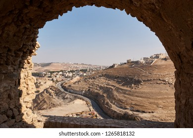 View of the Royal road through the arched window of the Crusader Castle or Kerak Castle. Al-Karak, Jordan, Middle East