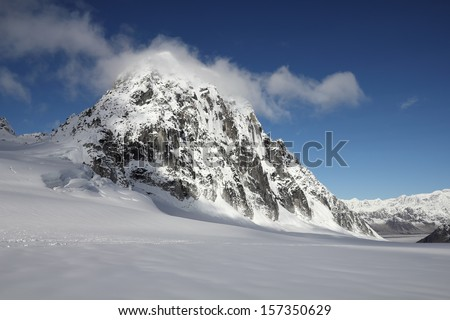 View of the Royal Tower Rock Formation after Landing on the Pika Glacier in Denali National Park, Alaska