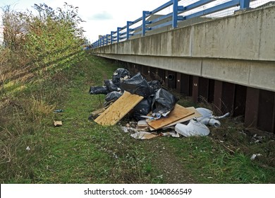A view of rubbish dumped on a public pathway