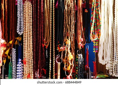View of Rudraksh and beads hanging in a street shop, ahmedabad, india.