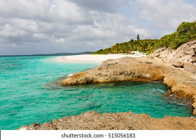 view at rugged rocky seashore and white sand empty beach at anguilla, island in caribbean sea