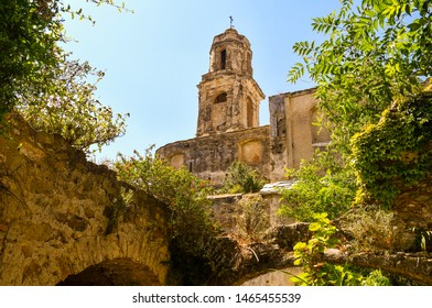 View of the ruins of the Church of Sant'Egidio, whose bell tower has miraculously escaped the earthquake of 1878 that caused the abandonment of the medieval village, Bussana Vecchia, Imperia, Italy