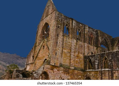 A view of the ruins of Tintern Abbey found in Wales.  Tintern is one of the many religious buildings that was destroyed by Henry VIII.