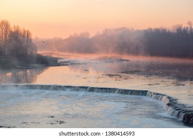 View of the Rumba Falls in the city of Kuldiga, Latvia. Early spring morning.