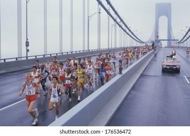 View of runners crossing Verrazano Bridge at the start of NY City Marathon
