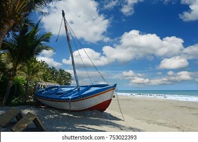 View of rustic boat at the beach in Mancora Beach Peru