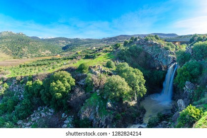 View of the Saar Waterfall, with Mount Hermon and Nimrod Fortress in the background, in the Golan Heights, Morthern Israel