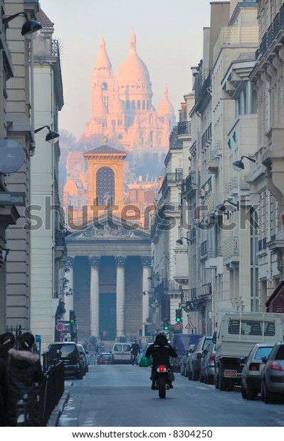 View of Sacre Coeur behind Notre Dame de Lorette from the Rue Lafitte in downtown Paris.