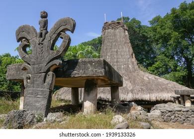 View of sacred ancient Watu Kajiwa megalithic tomb and carved headstone in traditional Prai Goli village, West Sumba island, East Nusa Tenggara, Indonesia