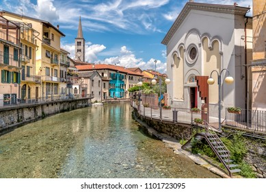 View of the Sacred Heart Oratory on the canal and Sant Ambrogio church in the historic center of Omegna, province of Verbano-Cusio-Ossola, Piedmont, Italy