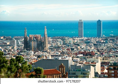 View of Sagrada Familia and port from Park Guell. Barcelona, Spain.