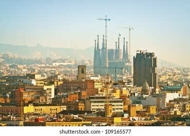 View of Sagrada Familia in scaffolding on the background of the morning (Barcelona, Spain, Europe)