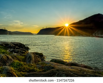 View of the Saguenay Canadian Fjord at sunset, bright rays of the sun