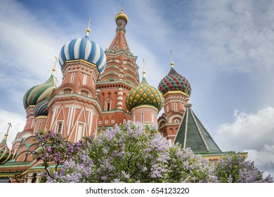 View of the Saint Basil's cathedral and the blossoming lilac bushes from the Red Square in central Moscow, Russia